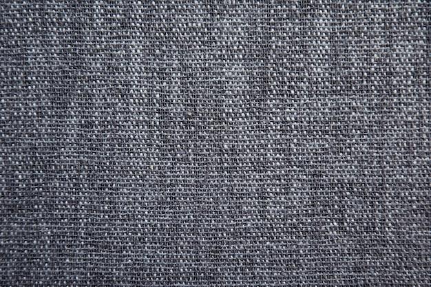 Priorità bassa di struttura del tessuto di cotone grigio.