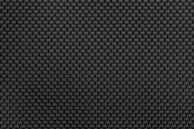 Priorità bassa di struttura del tessuto di nylon nero per il disegno.