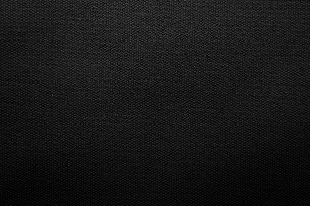 Priorità bassa di struttura del tessuto nero. dettaglio di materiale tessile in tela.