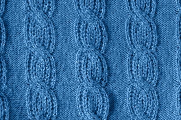 Priorità bassa di struttura della lana lavorata a maglia blu