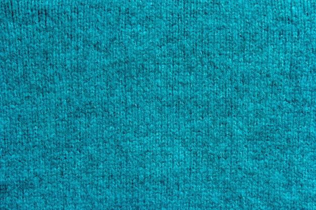 Priorità bassa di struttura della lana tricottante blu.