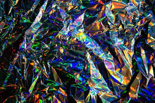Priorità bassa di struttura della stagnola della sirena iridescente olografica vaga estratto. colori d'argento alla moda futuristici al neon