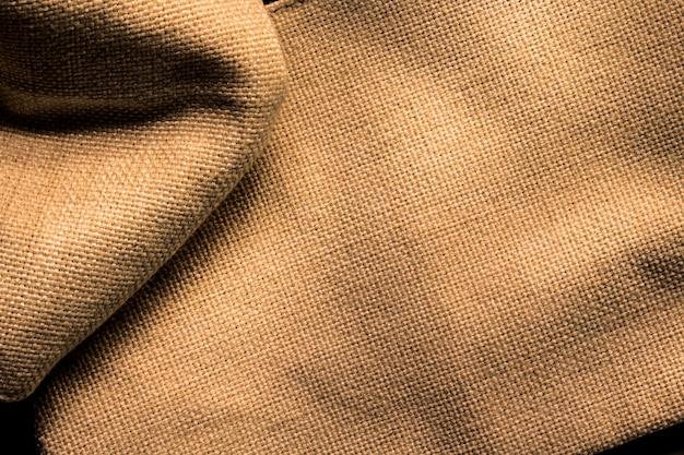 Priorità bassa di struttura della tela da imballaggio. superficie di tessuto vecchio marrone.