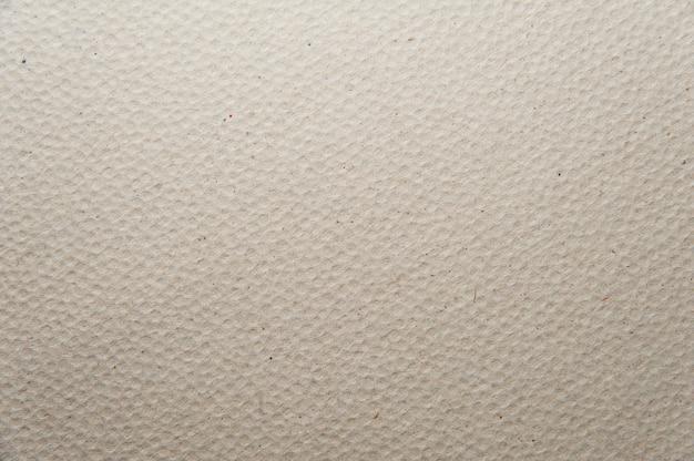 Priorità bassa di struttura di carta grigia - una superficie sporca strutturata. foto a macroistruzione