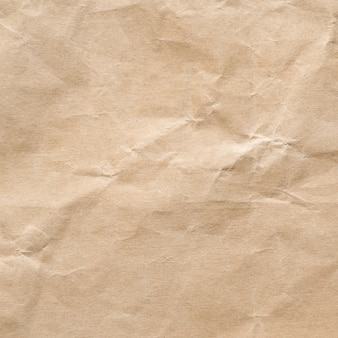 Priorità bassa di struttura di carta sgualcita marrone.