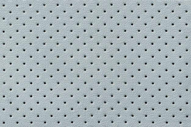 Priorità bassa di struttura di cuoio blu-chiaro perforata, sfondo dalla pelle della grinza,