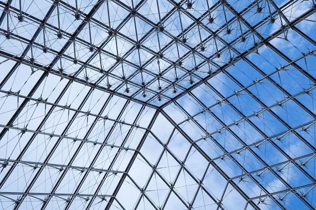 Priorità bassa di vetro astratta di struttura dal louvre