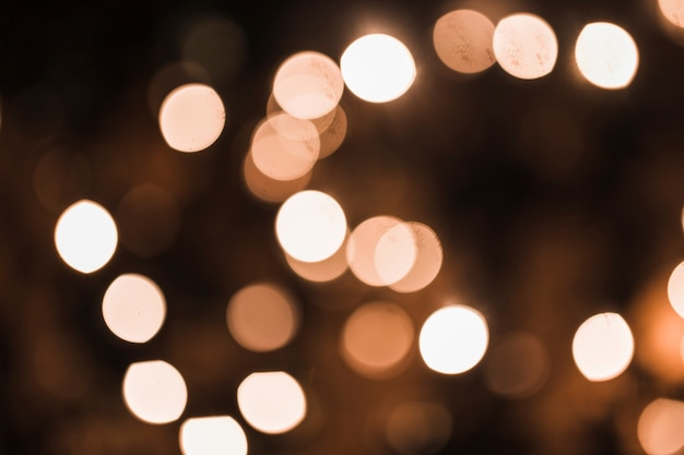 Priorità bassa festiva con punti luce e bokeh