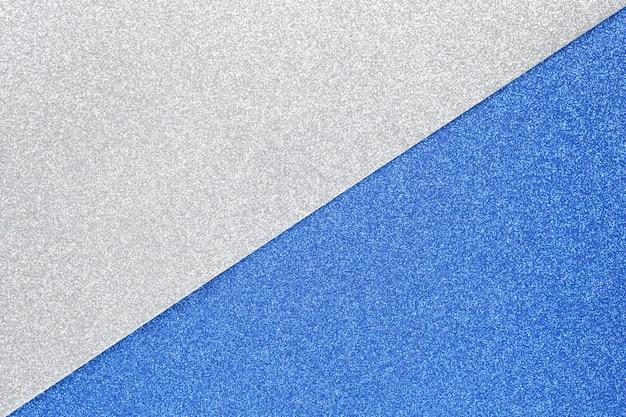 Priorità bassa festiva scintillante d'argento e blu
