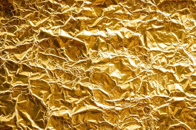Priorità bassa sgualcita di struttura della lamina di oro