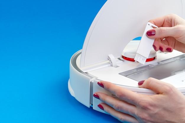 Procedura per la pulizia dell'aspirapolvere robot