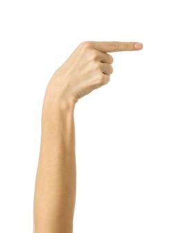 Puntando a destra. gesturing della mano della donna isolato su bianco