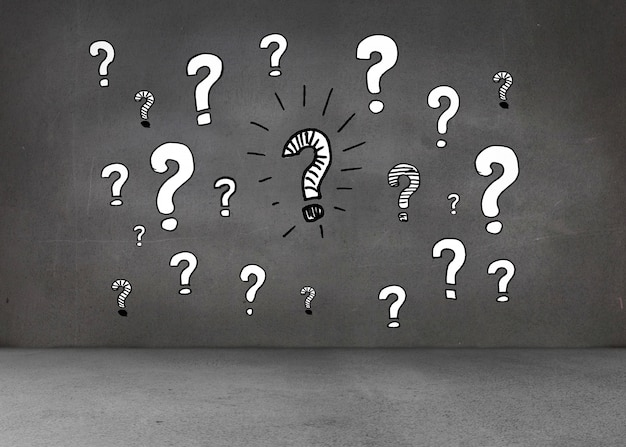 Punti interrogativi bianchi sul muro scuro
