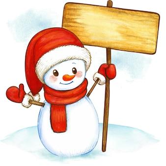 Pupazzo di neve dell'acquerello che tiene un'insegna di legno
