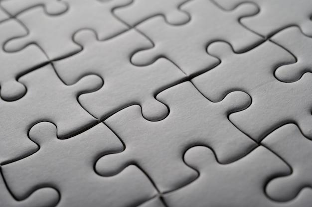 Puzzle di colore bianco, griglia di pezzi del puzzle, successo.