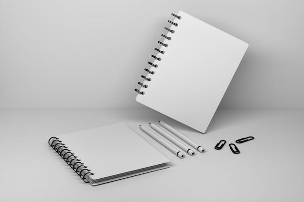 Quaderno a spirale due con copertina vuota e tre matite
