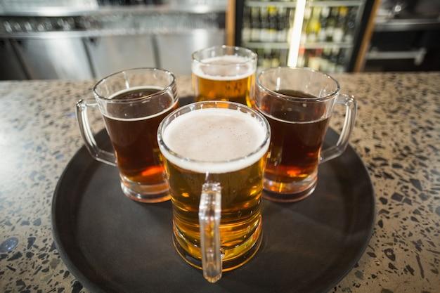 Quattro bicchieri di birra