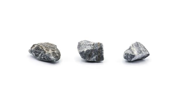 Raccolta di una piccola roccia isolata su sfondo bianco