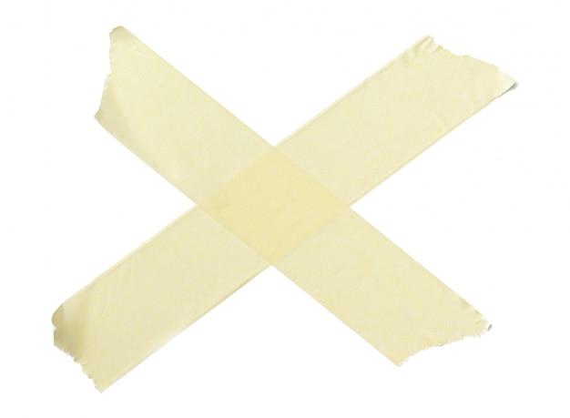 Raccolta di vari pezzi di nastro adesivo su bianco