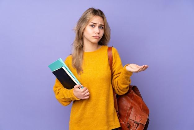 Ragazza dello studente dell'adolescente su viola infelice per non capire qualcosa