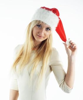 Ragazza di natale su bianco con il cappello della santa