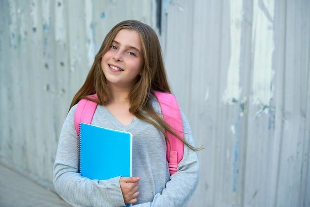 Ragazza studentessa bionda bambino torna a scuola