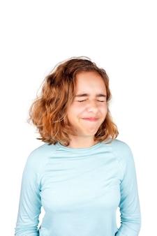 Ragazza sveglia dell'adolescente con l'espressione divertente del fronte che guarda alla macchina fotografica ,. pesce d'aprile