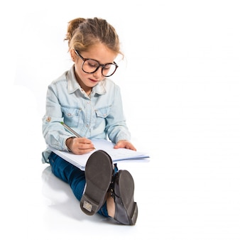 Ragazzino studente con libri. torna al concetto di scuola