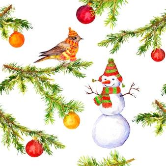 Ramo di albero di natale, pupazzo di neve e modello di uccelli