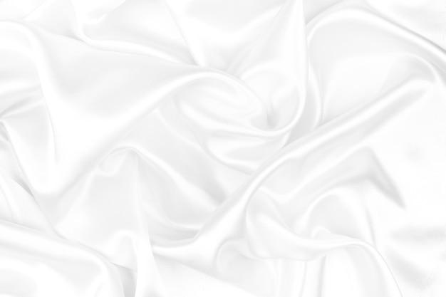 Raso lussuoso di seta bianca per sfondo astratto. focalizzazione morbida