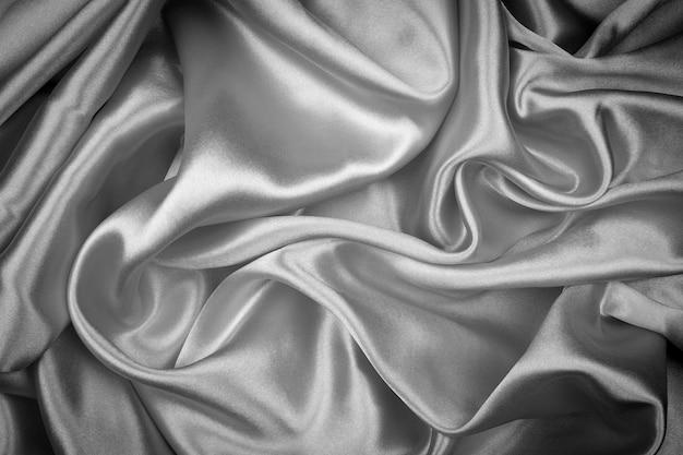 Raso lussuoso di seta nera per sfondo astratto. tono scuro