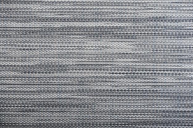 Real tessuto a maglia grigio melange fatto di fibre sintetiche con texture di sfondo