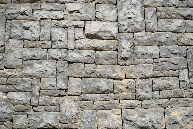 Resistente muro di pietra grigia