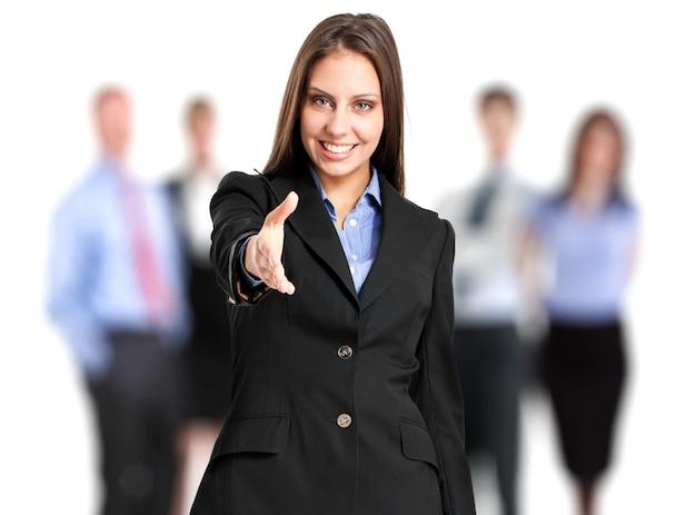 Responsabile femminile dandovi la sua mano davanti alla sua squadra