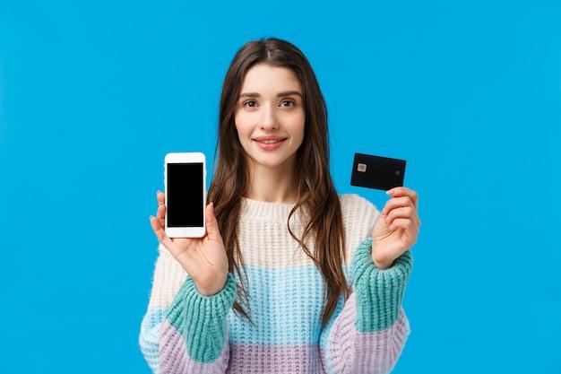 Ritratto assertivo giovane donna che sorride, mostrando come funziona il sistema bancario