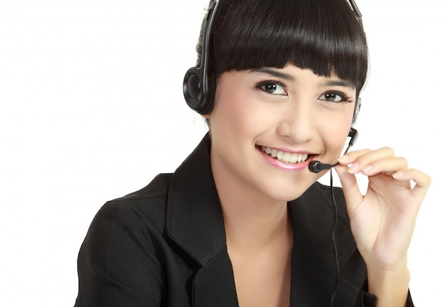 Ritratto dell'operatore allegro sorridente felice del telefono di sostegno in cuffia avricolare