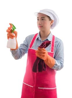Ritratto della donna attraente asiatica domestica domestica curiosa della donna che fa il lavoro della casa