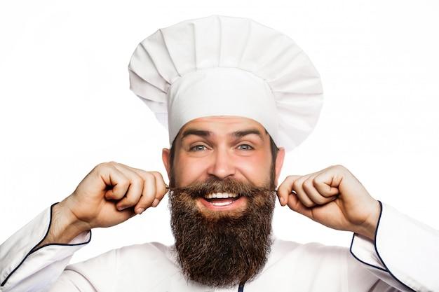 Ritratto di un allegro chef maschio barbuto.