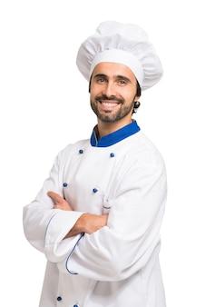 Ritratto di un cuoco unico fiducioso isolato su bianco