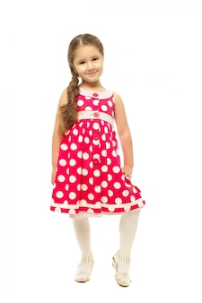 Ritratto di una bella bambina in abito rosa