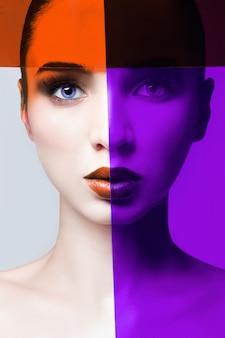 Ritratto di una donna di primo piano con un film rosso e viola sul viso, labbra perfette e pelle pulita e bella. cura del viso, trucco perfetto