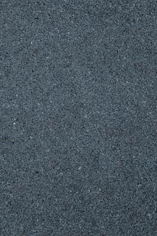Rivestimento del suolo dipinto grigio scuro all'esterno alla luce del giorno