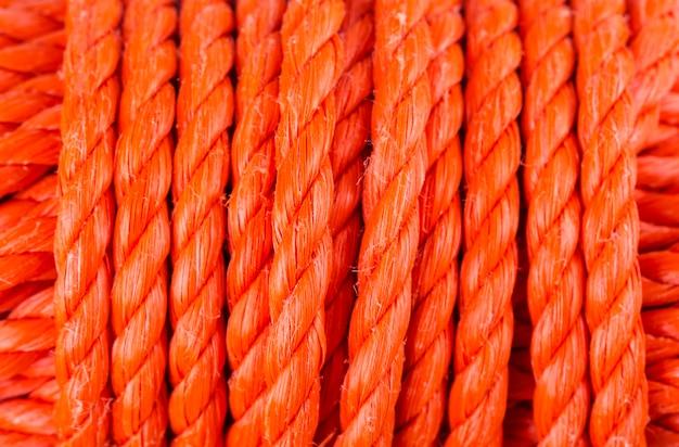 Rotoli la struttura del fondo rosso della corda di nylon