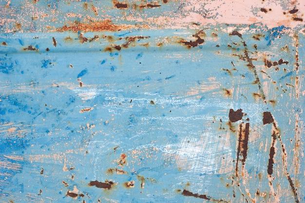 Ruggine con texture vernice scrostata. struttura in metallo graffiato con vernice. texture di vernice spalmata