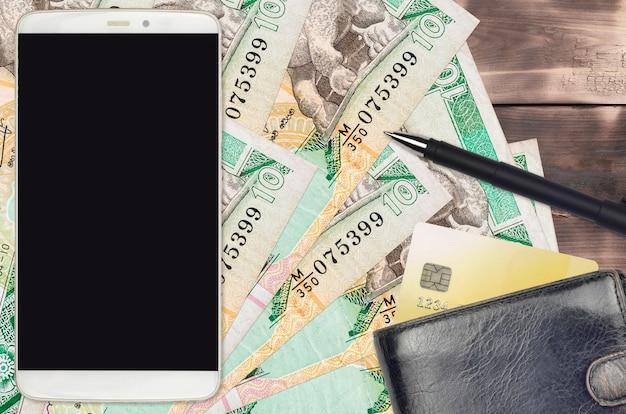 Rupie dello sri lanka fatture e smartphone con borsa e carta di credito