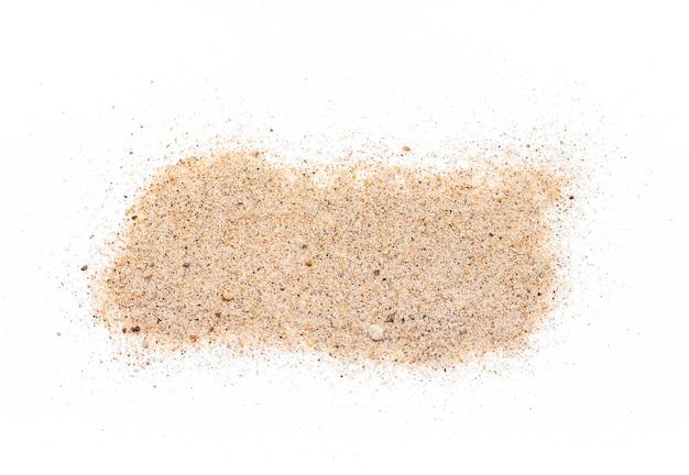 Sabbia marrone chiaro granulosa reale isolata