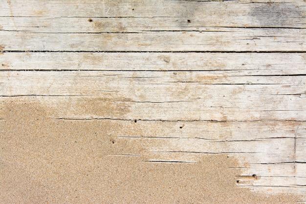 Sabbia su legno planked. priorità bassa di estate con lo spazio della copia. vista dall'alto