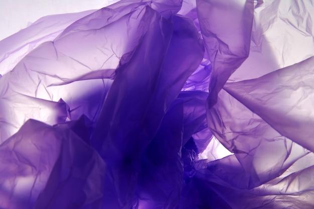 Sacchetto di plastica. sfondo di arte astratta. struttura viola del fondo di pendenza dell'acquerello.