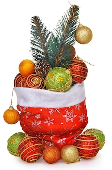 Sacchetto regalo di babbo natale pieno di giocattoli con ramo di albero di natale