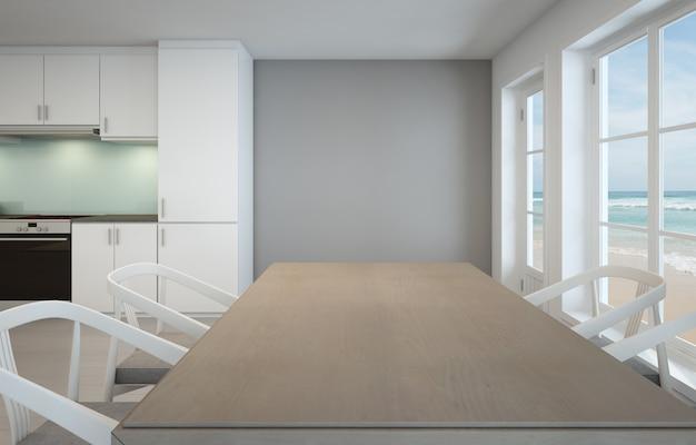 Sala da pranzo con vista mare e cucina in casa sulla spiaggia di lusso.
